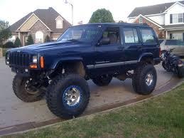 lifted jeep blue 2000 xj patriot blue 8