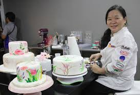 cake maker chef penk ching gives a tutorial on painting cakes chefs tricks