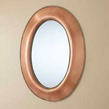 medium oval lightly hammered copper mirror with brass accents