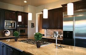 neutral dark cabinets granite countertop glass tile contemporary