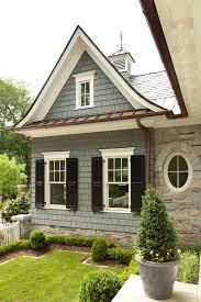 cedar shingle siding bronze and copper white and black windows