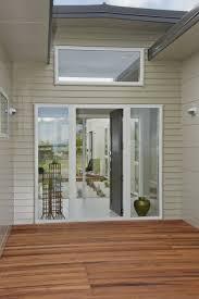 scyon linea weatherboard merbau decking white windows white