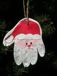 santa handprint and reindeer footprint ornaments made with a