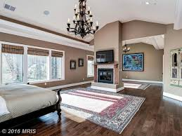 Cathedral Ceilings In Living Room by Traditional Master Bedroom With Chandelier U0026 Metal Fireplace In