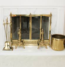 solid brass fireplace screen with andirons and various accessories