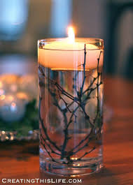 floating candle centerpiece ideas floating candle with twigs picmia