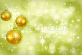 yellow christmas ornaments on a green background defocused stock