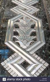 art deco metal work relief inlaid into marble or granite outside