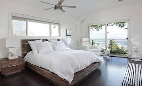 contemporary bedroom nuanced in cool white and equipped with