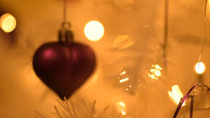 heart shaped christmas lights heart shaped christmas tree decoration hanging in a christmas tree