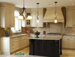 white kitchen black island antique white cabinets light granite antique black island my
