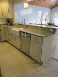 cabinets by omega cabinetry with a quatrz countertop by