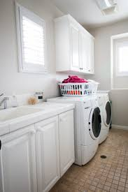 Laundry Room Storage Between Washer And Dryer by Laundry Room Plans A Thoughtful Place