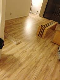 How To Lay Wood Laminate Flooring How We Put Hardwood Over Carpet Messymom