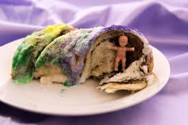 mardi gras king cake baby here s why there s a plastic baby jesus hiding inside your king