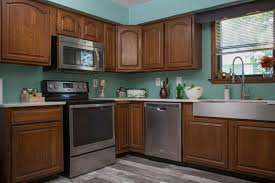 how to paint stained kitchen cabinets paint your kitchen cabinets without sanding or priming diy