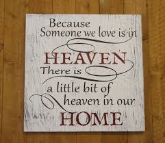 in memory wood sign because someone we love is in heaven