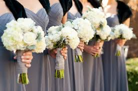 wedding flowers for bridesmaids wear grey dresses black shrugs ivory wedding flowers bouquets