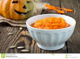 pumpkin porridge on a background of funny halloween pumpkin stock