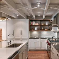 brownstone garden level kitchen with exposed ceiling joists