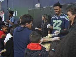 seattle seahawk c j prosise throws early thanksgiving for