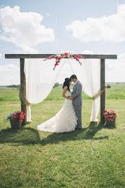 wedding arches outdoor pink and gray outdoor familly farm wedding ceremony arch wedding
