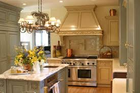 beautiful galley kitchen remodel with elegant chandelier and gold