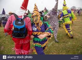 traditional cajun mardi gras costumes revelers in traditional cajun mardi gras costume during the