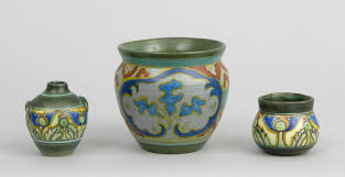 a group of gouda pottery pieces in