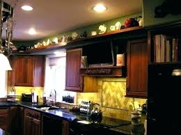 decorate above kitchen cabinets decorating above kitchen cupboards cottage farmhouse kitchens