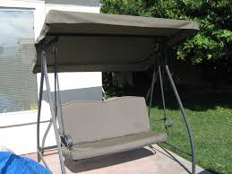 exterior grey wrought iron porch swing with tent canopy using