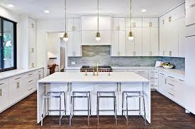 White And Gold Kitchen With CB Vapor Acrylic Bar Stools - Acrylic backsplash