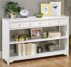 white console table with drawers love the baskets of books fun way to keep my favorite books in a