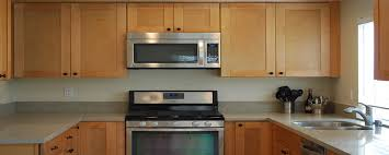paint vs stain kitchen cabinets paint vs stain on wood cabinets domain cabinets
