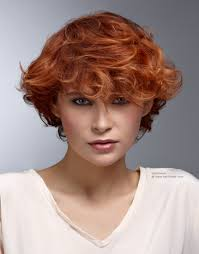 short hairstyle with longer top hair red curls and highlights