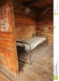 room with a metal bed frame and old mattress royalty free stock