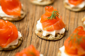 canape bouche smoked trout amuse bouche on a wooden table stock photo image of