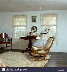 White Bedroom Rugs Cream Ponyskin Rug On Dark Wood Floor In White Bedroom With