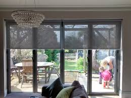 Patio Bi Folding Doors by Sunscreen Roller Blinds Over Bi Fold Doors In Living Room