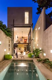 modern narrow house narrow house sandwiched between two buildings and a pool
