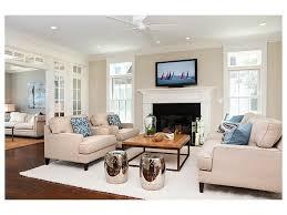 white shelves double hung windows trim fireplace arm chairs window