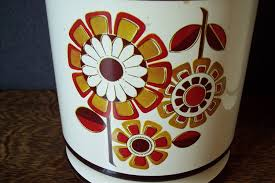 vintage 1970s metal kitchen canister set with floral design by