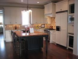 white kitchen cabinets with black island 17 best black islands images on kitchen islands black