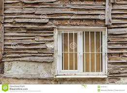 old wooden house wall paneling and window stock photo image