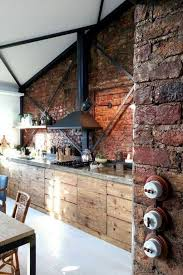 kitchen with brick walls and hood over stove rural rustic