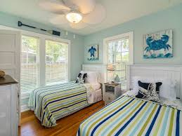 historic beach cottage walk bike to heart o vrbo fun and bright twin beds in second bedroom with ceiling fan