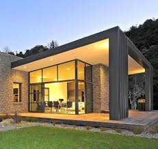 3 glass cubed volumes sheltered under roof define sustainable home