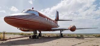 elvis plane elvis presley s custom made private jet with red velvet seats is set