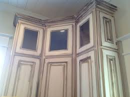 corner distressed white kitchen cabinets for yellow lamp shade