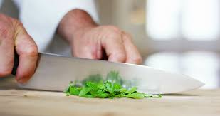 Used Kitchen Knives Chef Expert Cuts With A Professional Kitchen Knife Parsley